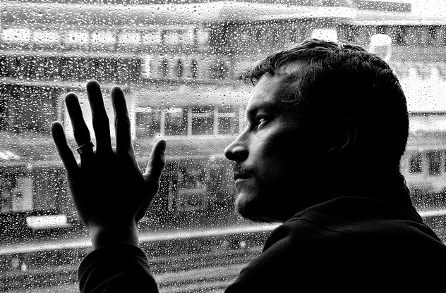 depressed adult male at rainy window adderall addiction support