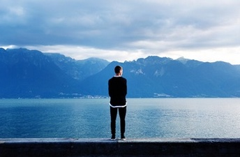 young man looking over lake adderall addiction support